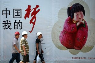 A group of Chinese workers walks past a 'Chinese Dream' promotion billboard in Beijing on September 2, 2013. A key index of China's manufacturing activity rebounded to 50.1 in August, its first month of expansion since April as market conditions improved, HSBC said on September 2.     AFP PHOTO / WANG ZHAO        (Photo credit should read WANG ZHAO/AFP/Getty Images)